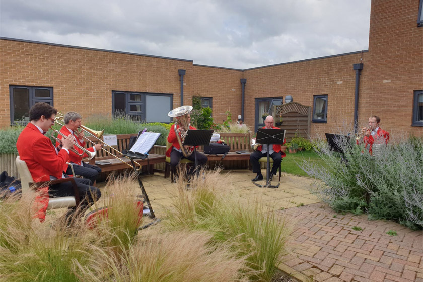 The London Fanfare Trumpets performing for residents at Wimborne House
