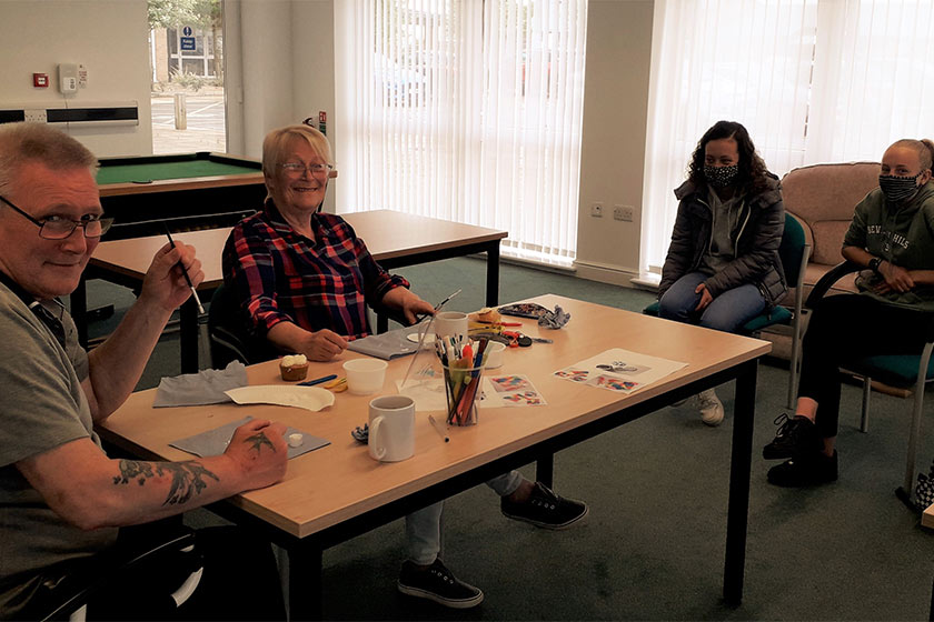 Staff and residents at Sanctuary Retirement Living's Jazz Court taking part in an arts and crafts session