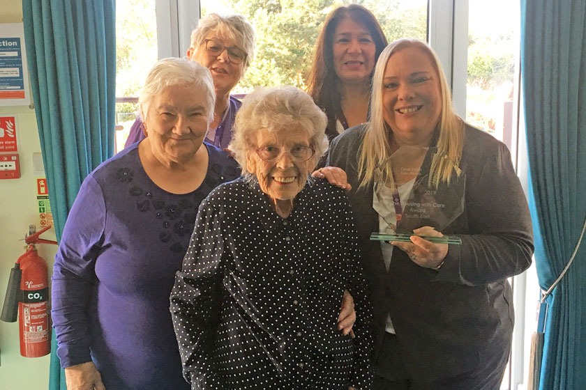 Staff and residents from St Bartholomew's Court with their award