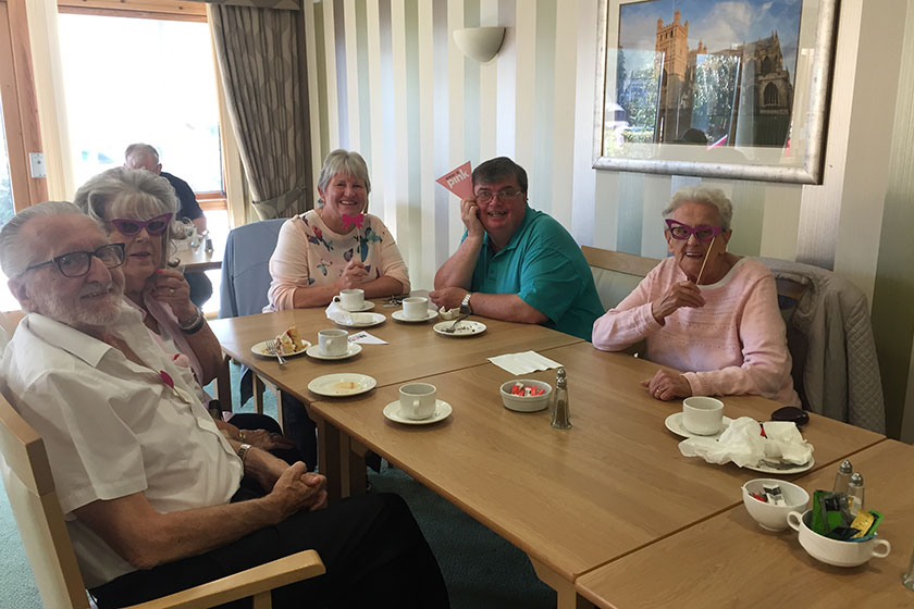 Residents of Dunboyne Court enjoying the Wear It Pink coffee morning in aid of Breast Cancer Now.