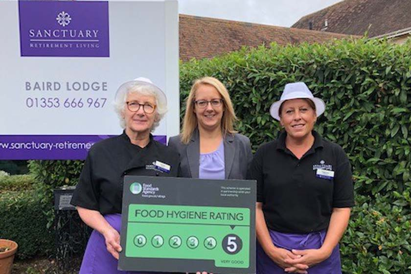 Staff at Baird Lodge celebrating rating