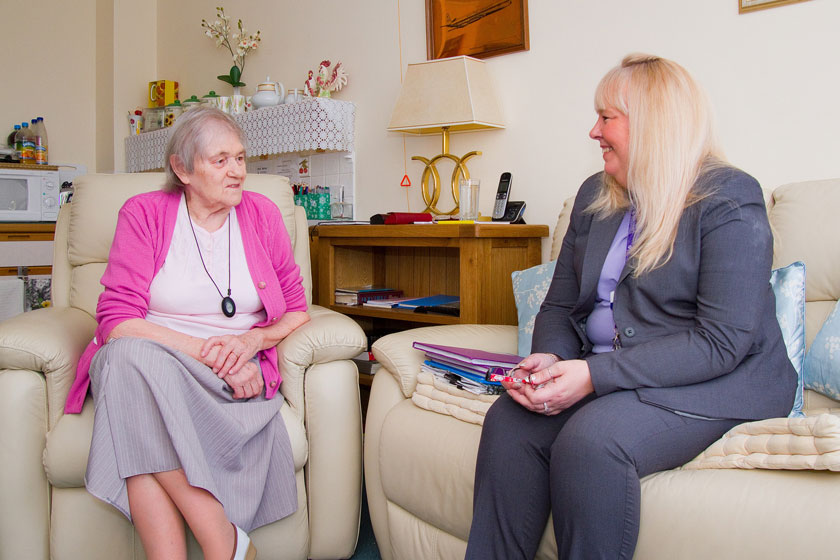 A Jubilee Court resident and staff chatting