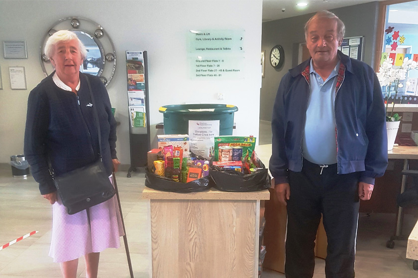 Residents with some of the food donations for the Telford Crisis Network
