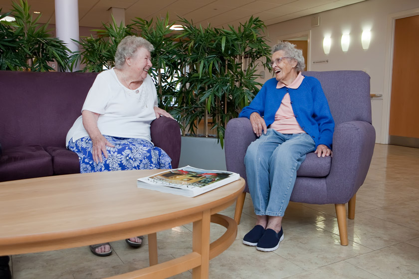 Two residents chatting in one of our communal areas.