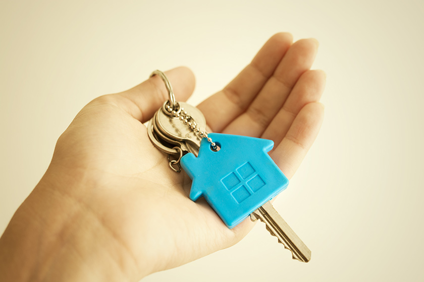 Older woman holding new house keys in her hand