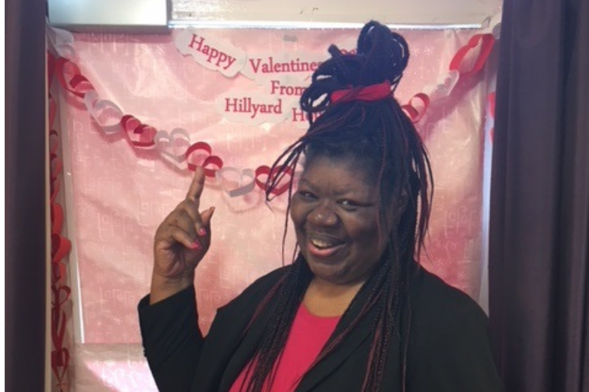 Hillyard House resident, Valerie Smith, is all smiles during a Valentine's Day celebration