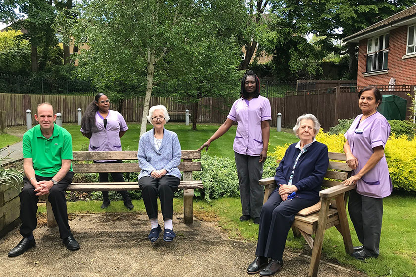 Staff and residents enjoy the communal gardens at Goodwin Court