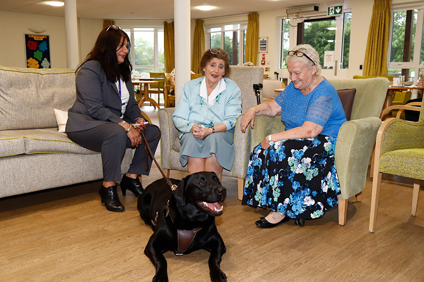Staff and residents enjoy a visit from a four-legged friend
