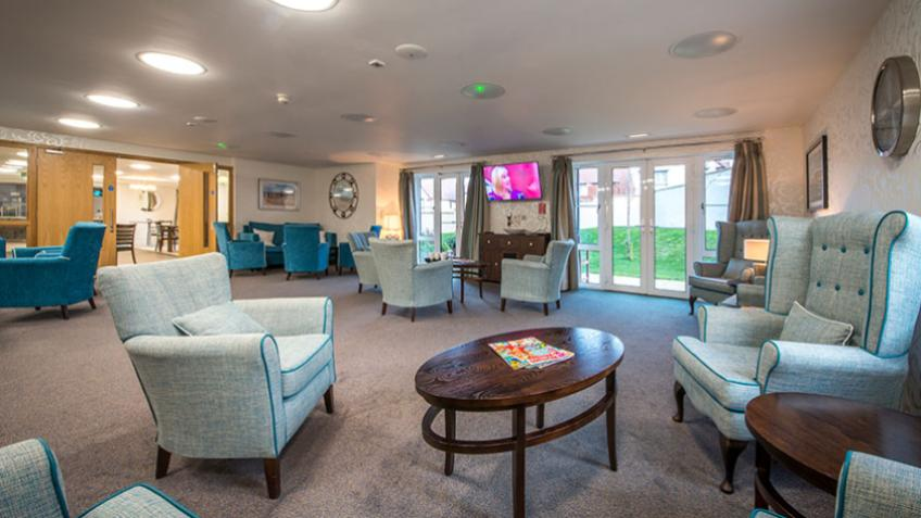 A communal lounge area at Moreton Court Retirement Living