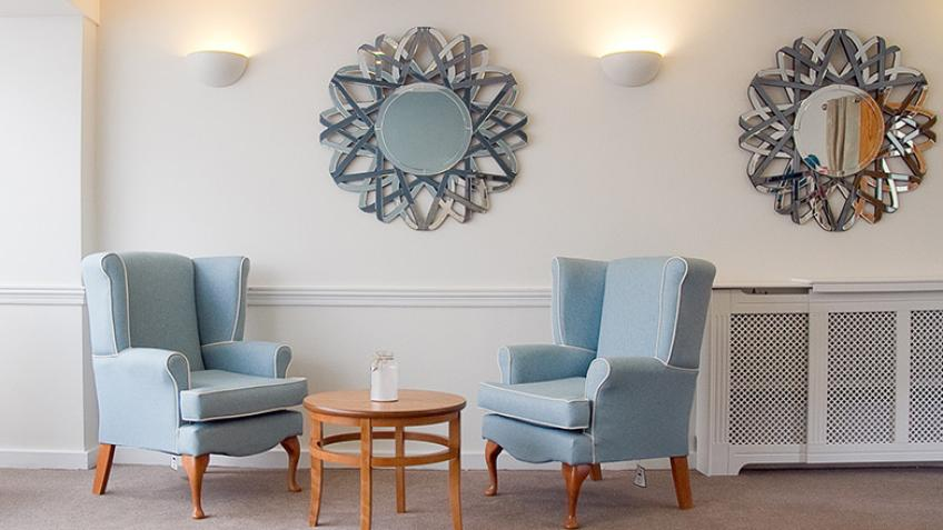 Ness Court living area with wingback chairs