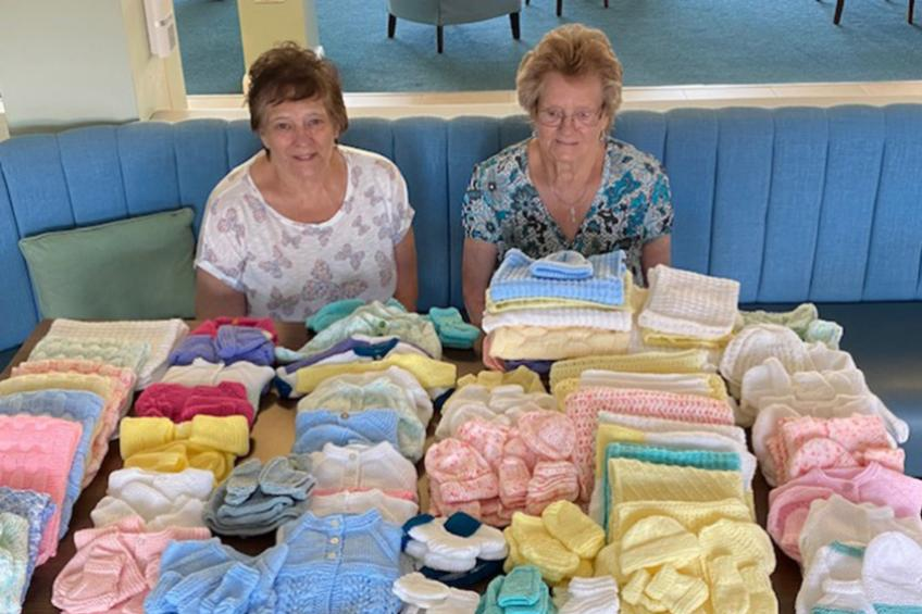 A picture of Baskeyfield House residents knit for national cause