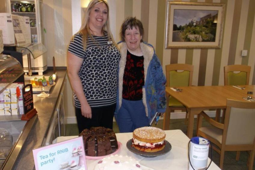 A picture of Dunboyne residents enjoy cake and tea for the RNIB