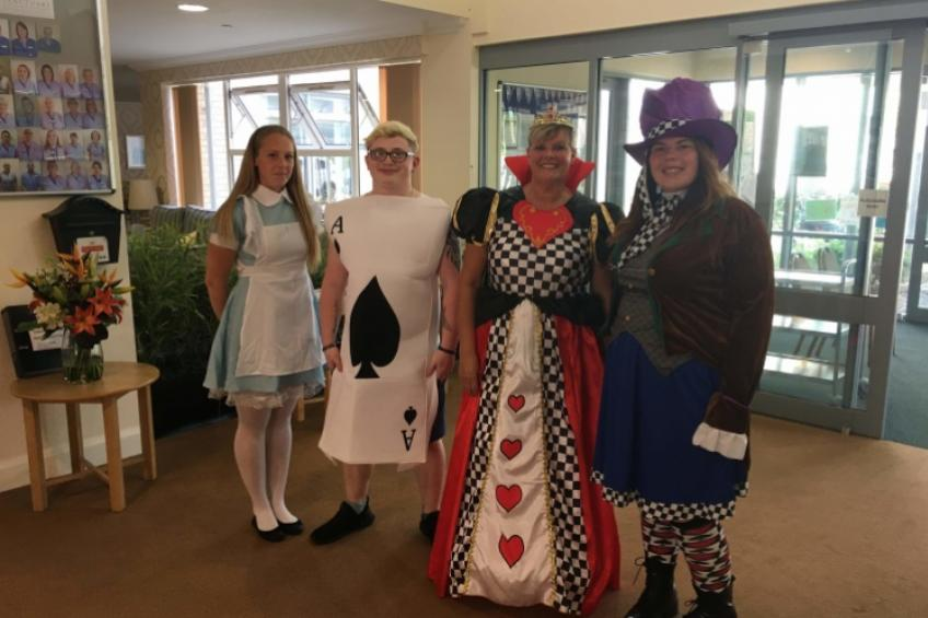 A picture of Retirement residents enjoy Mad Hatter's Tea Party