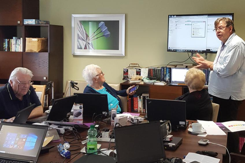 A picture of Noble House residents get hands on with the web