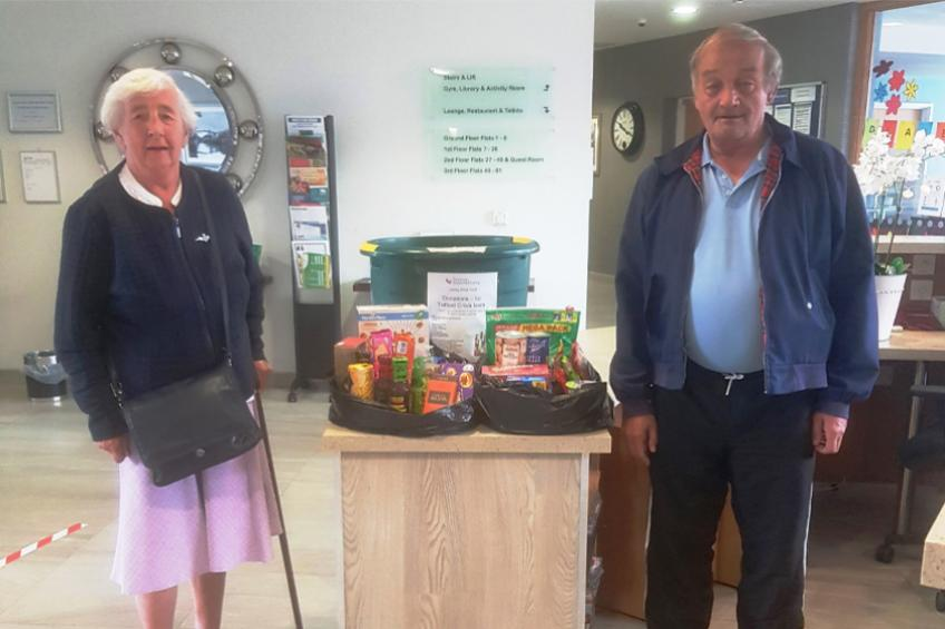 A picture of Residents donate food to help local community