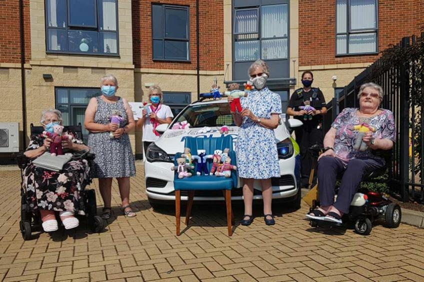 A picture of Retirement community knit teddies for local children