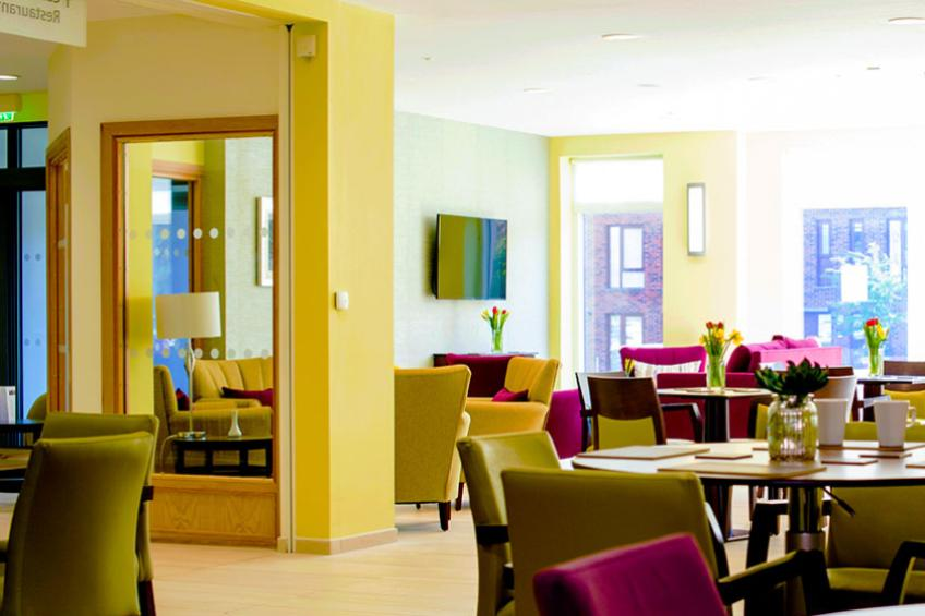 The dining area within the onsite restaurant at Rose Manor.