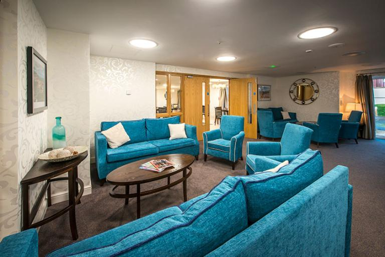 Comfy sofas in the lounge at Moreton Court Retirement Living